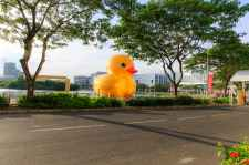 giant yellow rubber ducky on body of water at park