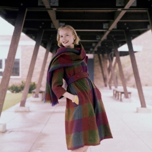 Christa Vogel modeling a plaid coat and scarf in 1958. Image from Flickr.