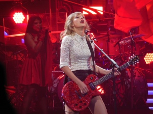 Taylor Swift performing in 2013. Image from Wikimedia commons.